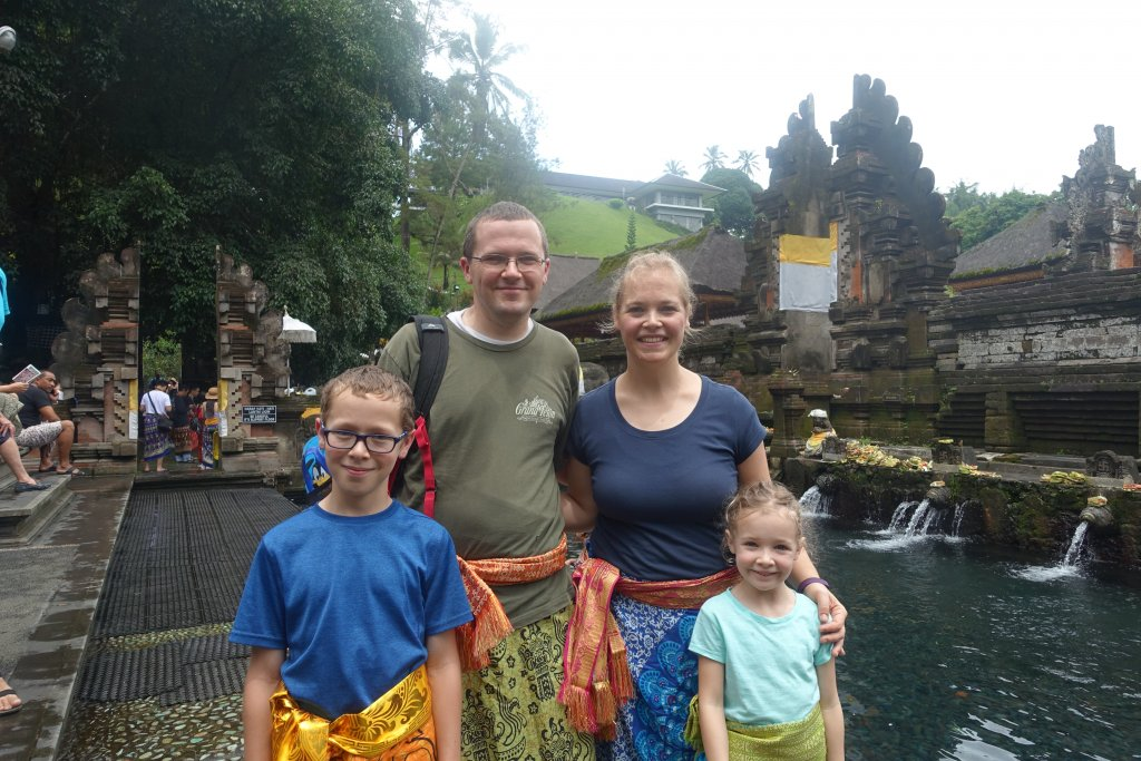 In sashes and sarongs at water temple
