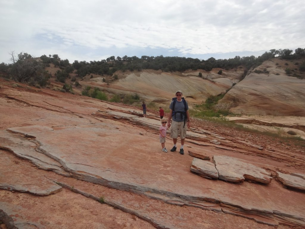 family on red rock