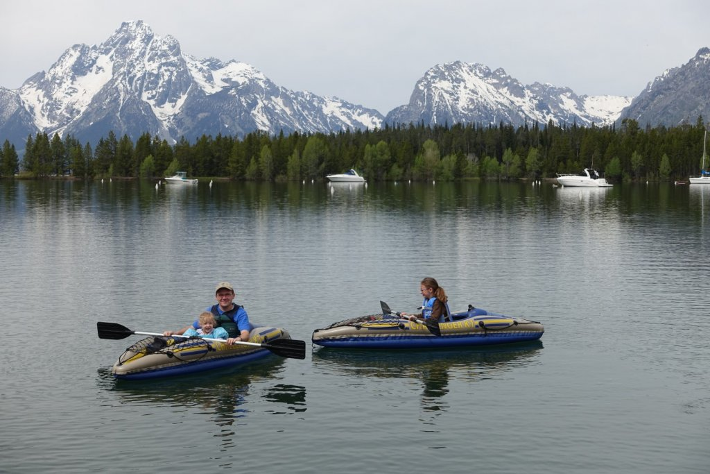 father and daughters kayaking