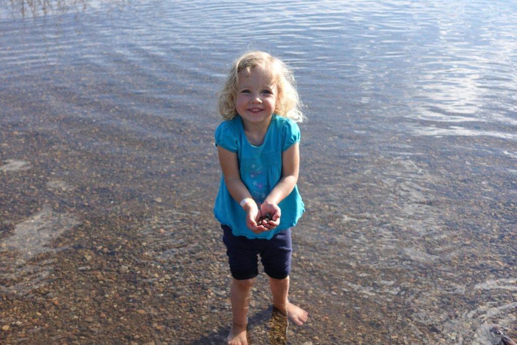 girl collecting rocks