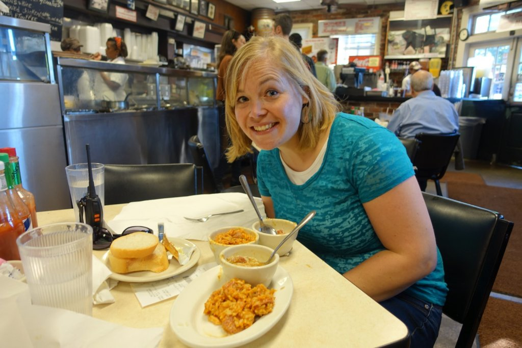 woman eating jambalaya and gumbo