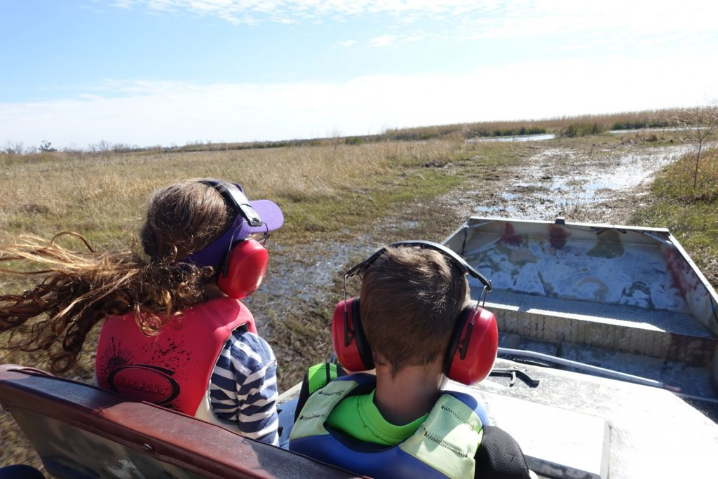 kids riding in an airboat