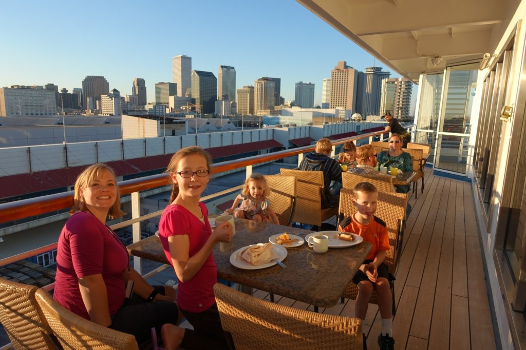 Family eating breakfast on cruise ship in port