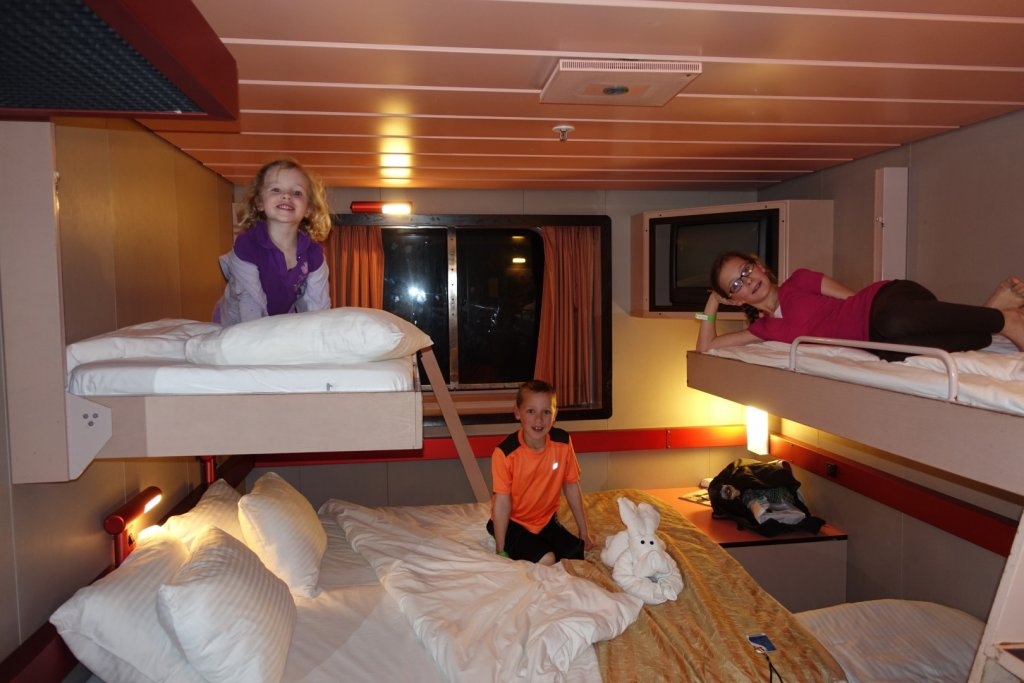 Kids on beds in stateroom on cruise ship