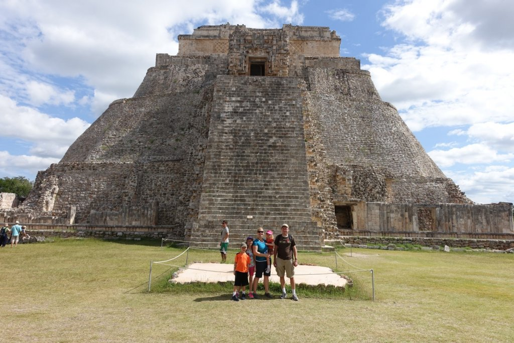 family in front of a Mayan temple