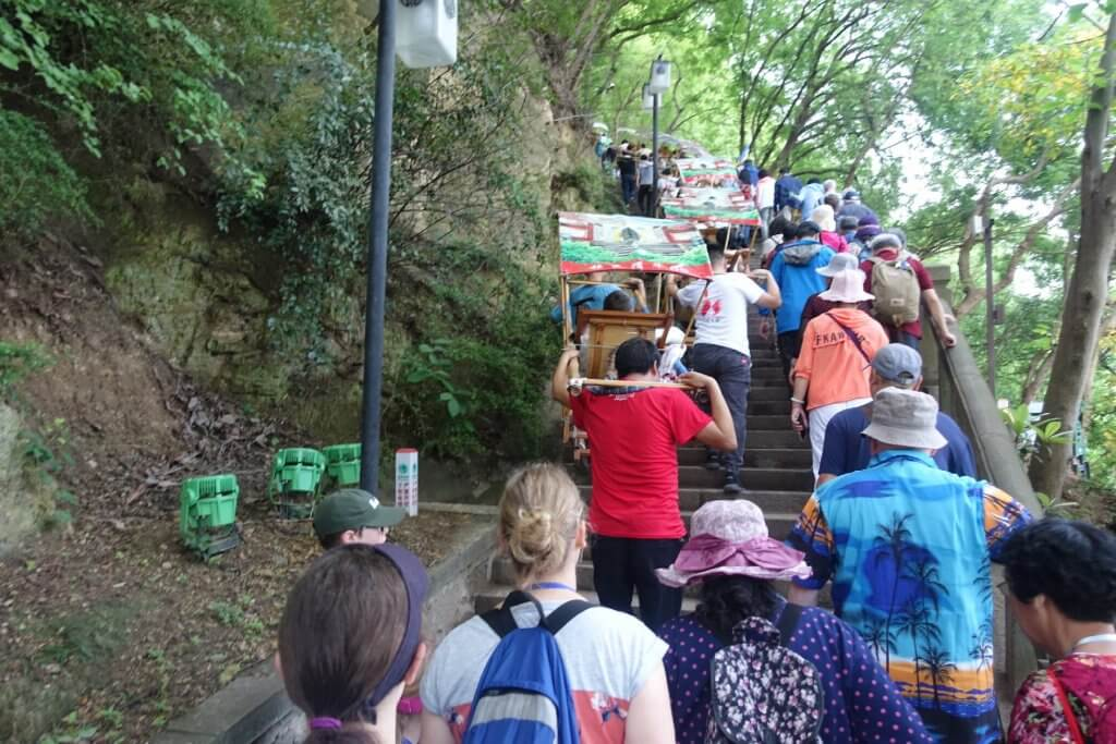 The Pagoda tour steps up the mountain