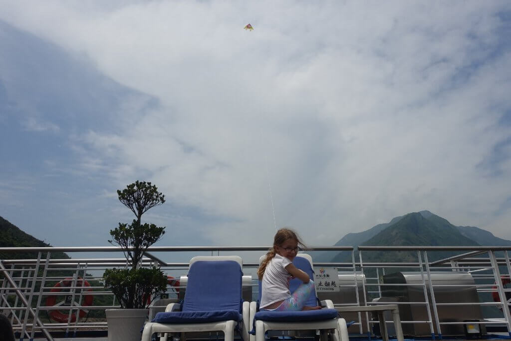 Flying a kite behind the ship