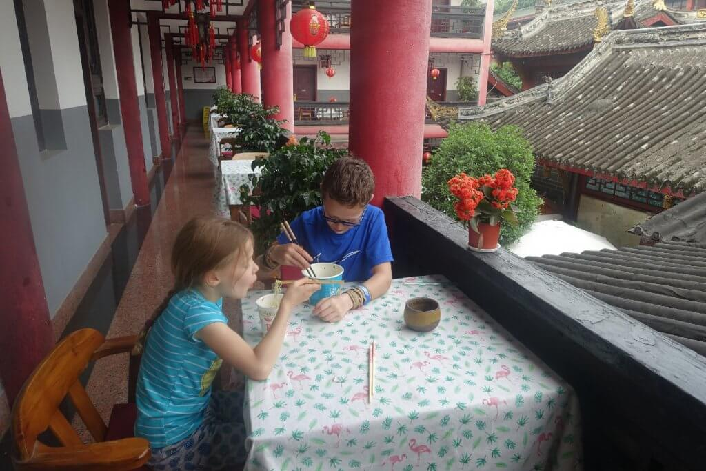 Eating noodles with chopsticks and the Wenshun Mansion Hotel