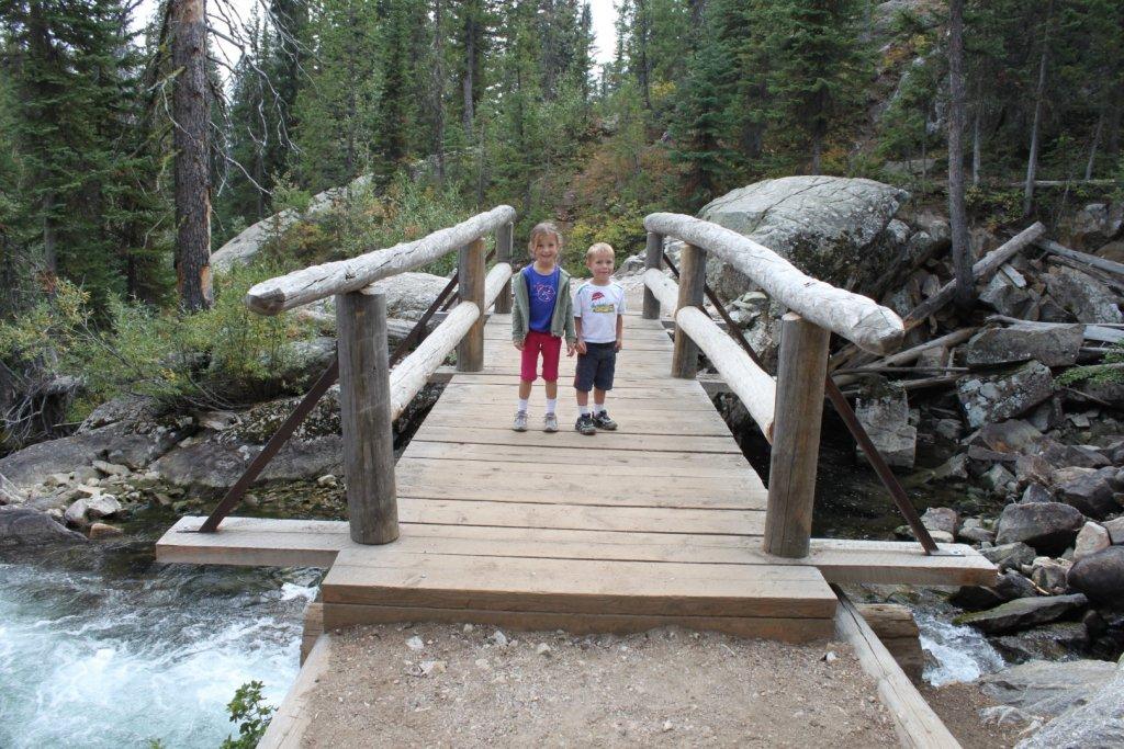 two kids on a bridge