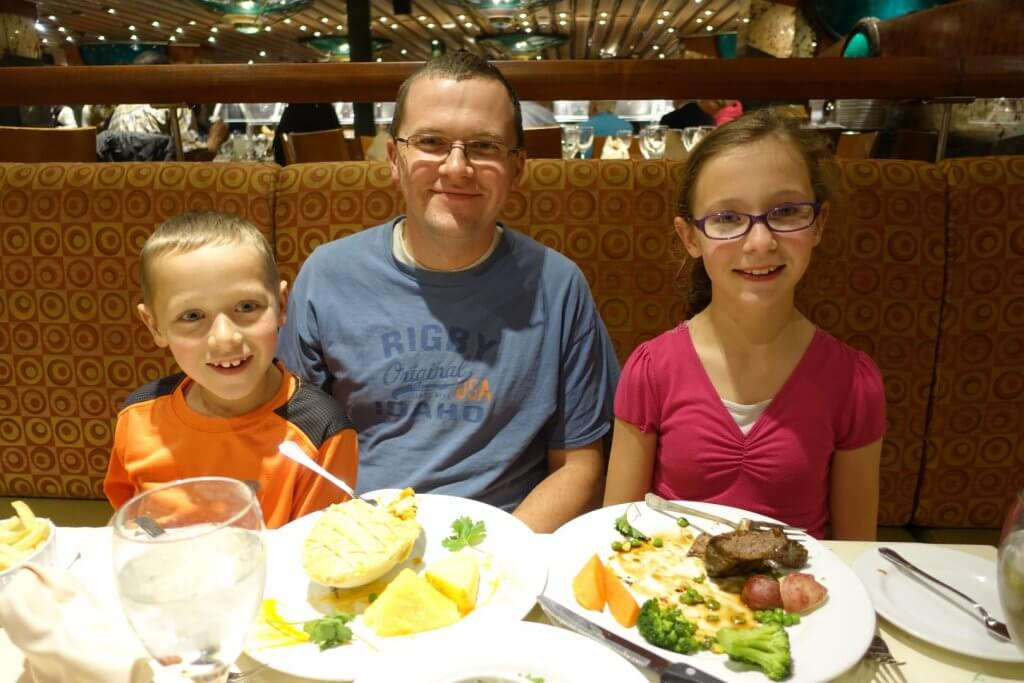 dad and kids with food on plates