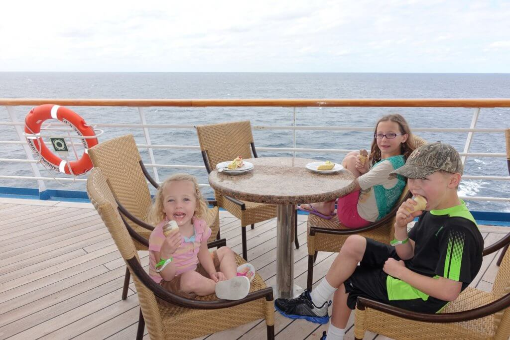 kids eating ice cream on the deck of a cruise ship