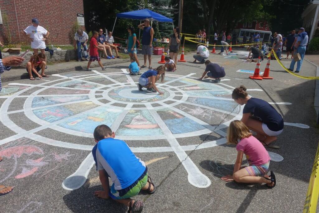 kids drawing with sidewalk chalk