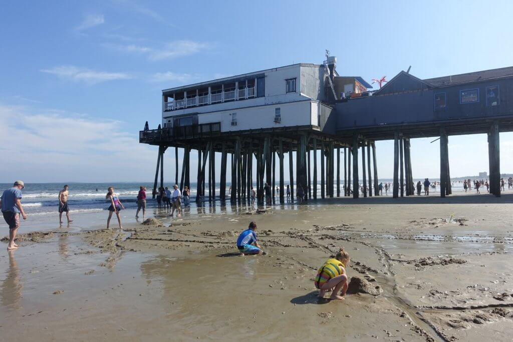 pier built up over a sandy beach