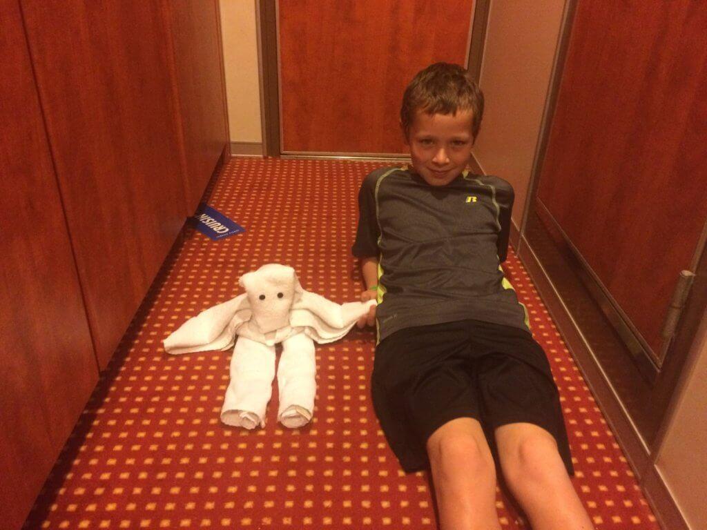 boy with a folded towel animal