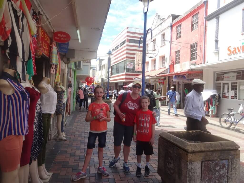 mom and kids on a street in Barbados