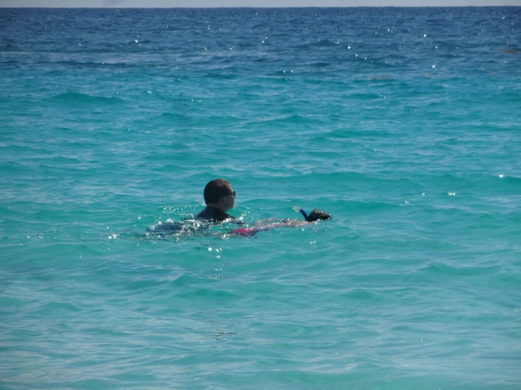 dad and daughter snorkeling in the ocean