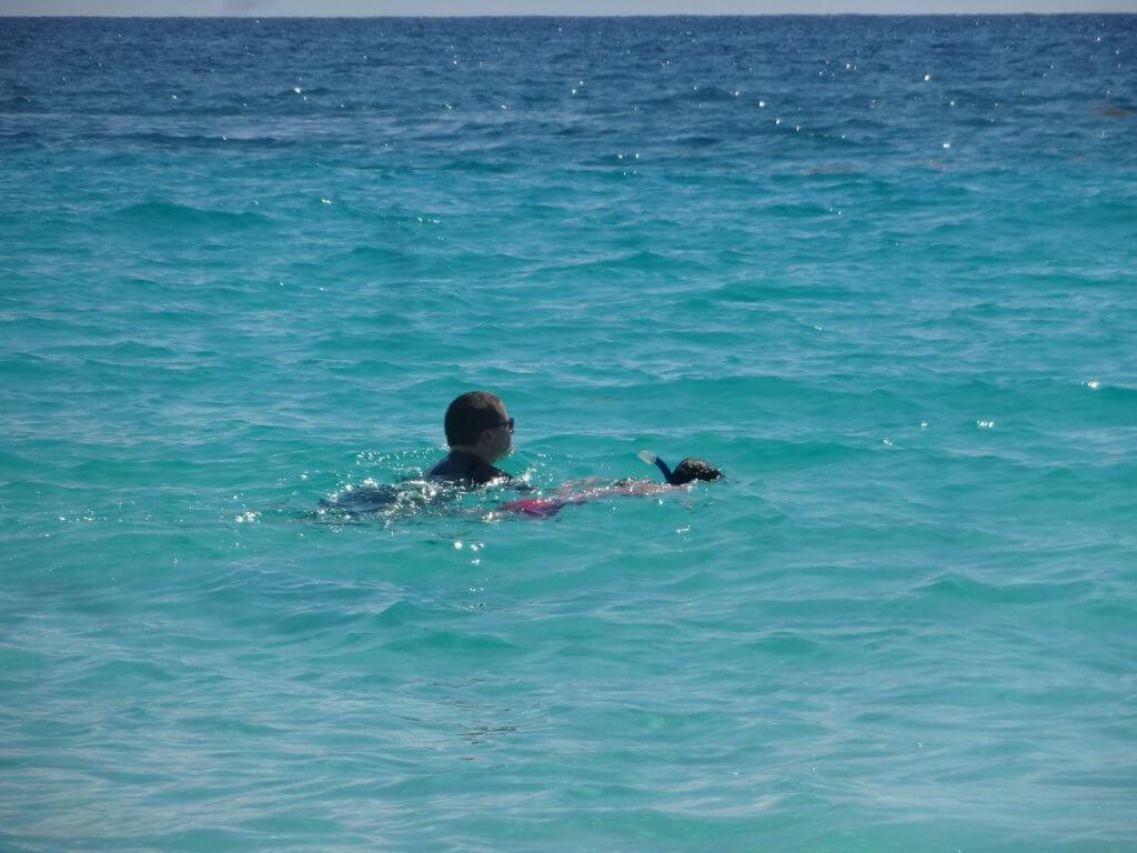 dad and daughter snorkeling in the ocean