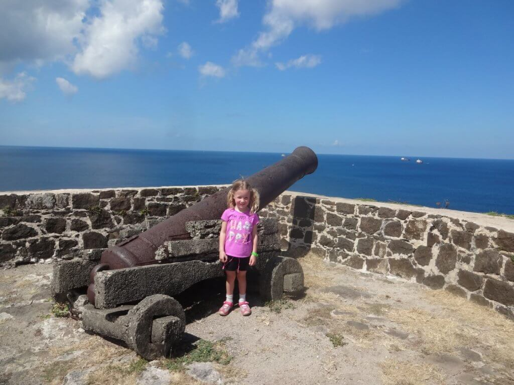 girl by an old cannon