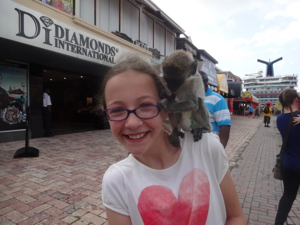 girl with a monkey on her shoulder