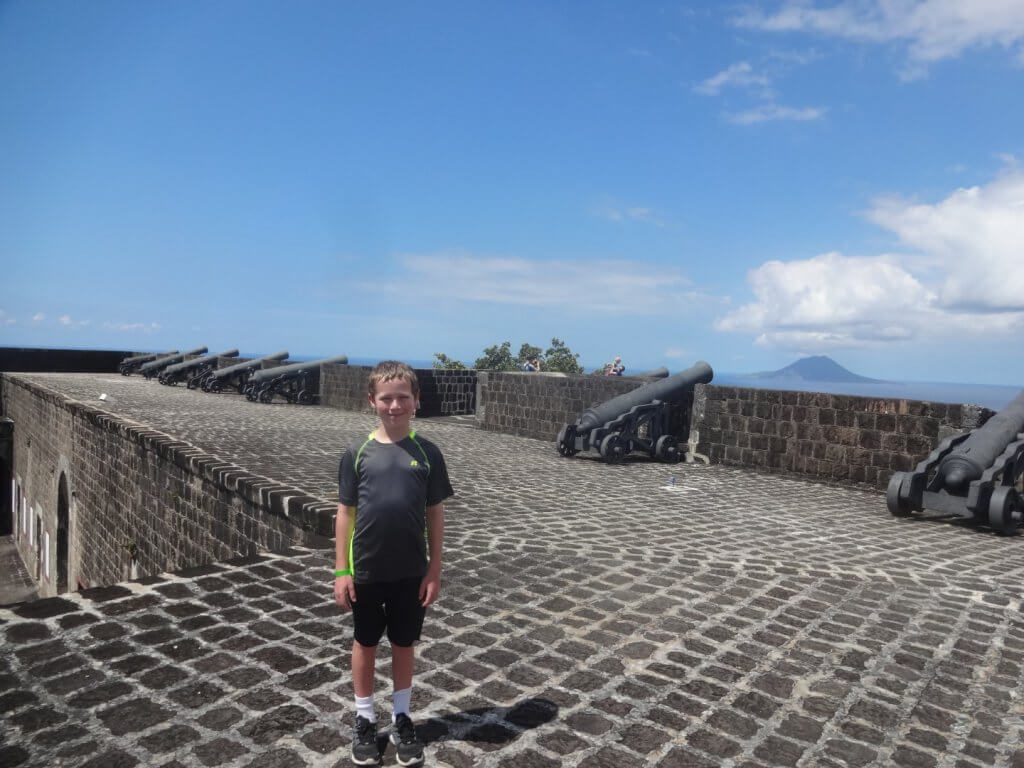 Boy at fort with cannons