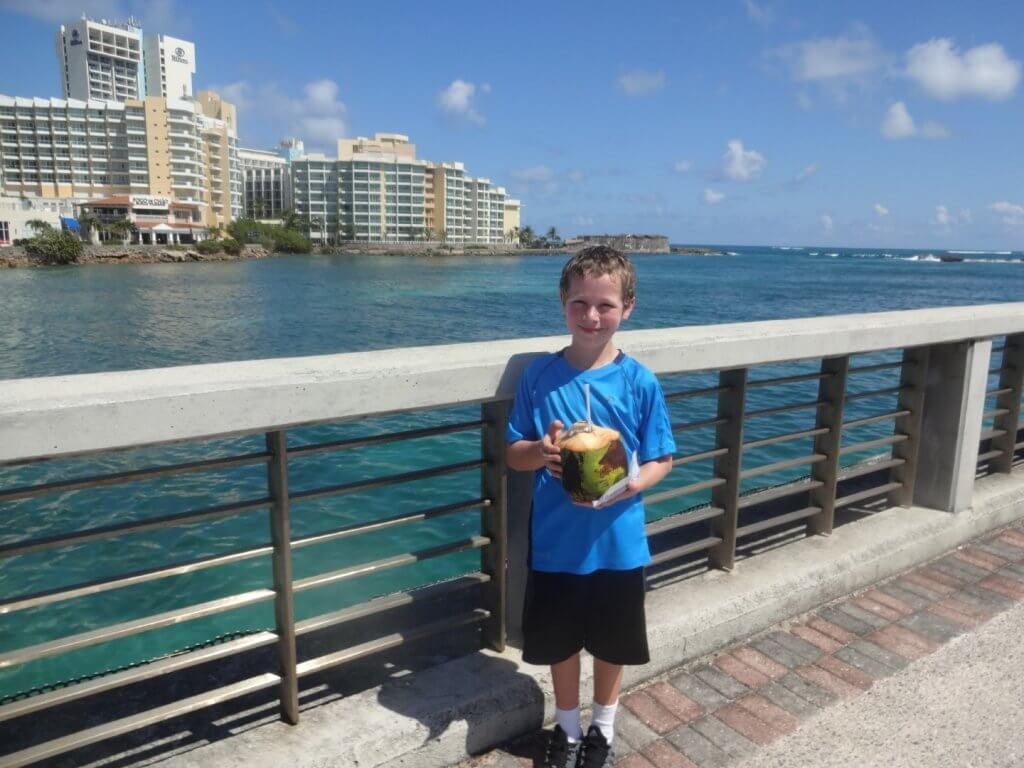 boy drinking from a coconut