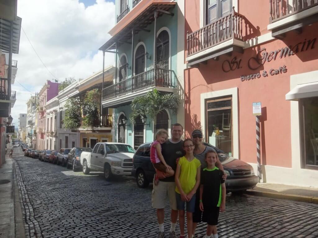 Family on a cobblestone street