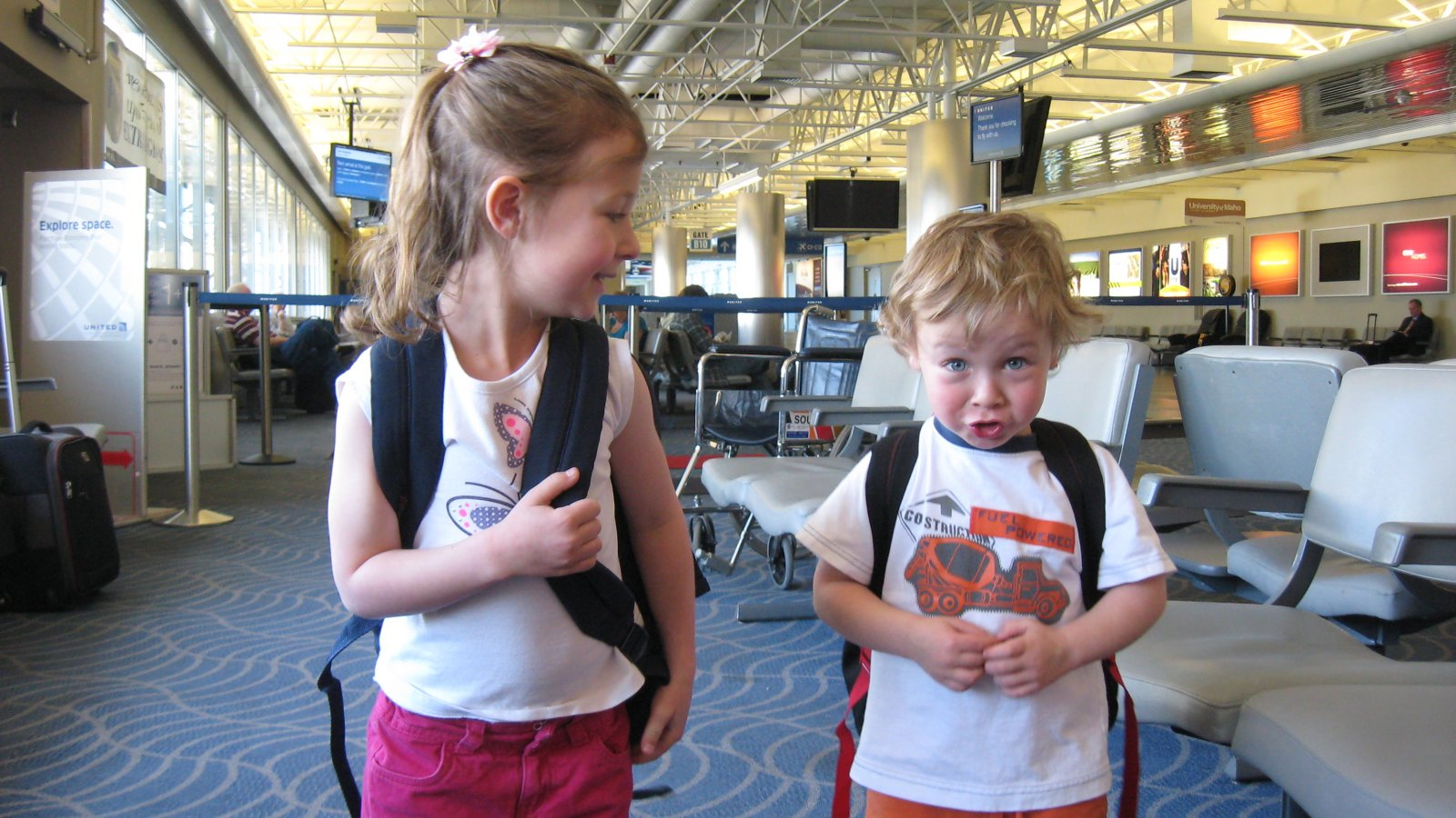 kids with backpacks in airport