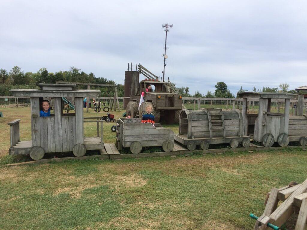 kids on a wooden train