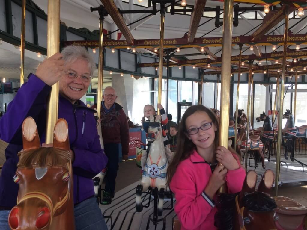 people on a carousel