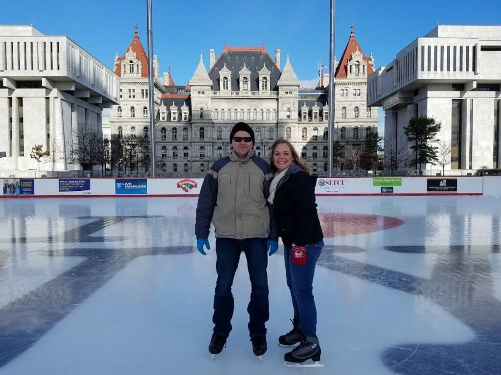 couple on ice skating rink