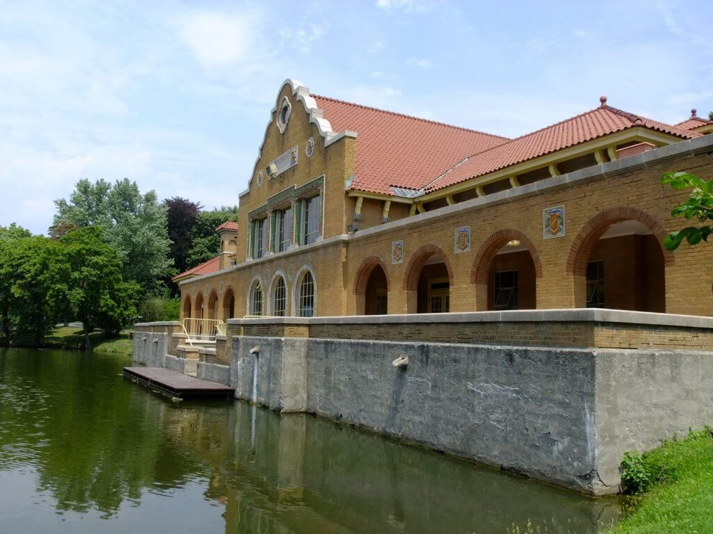 brick building on a lake
