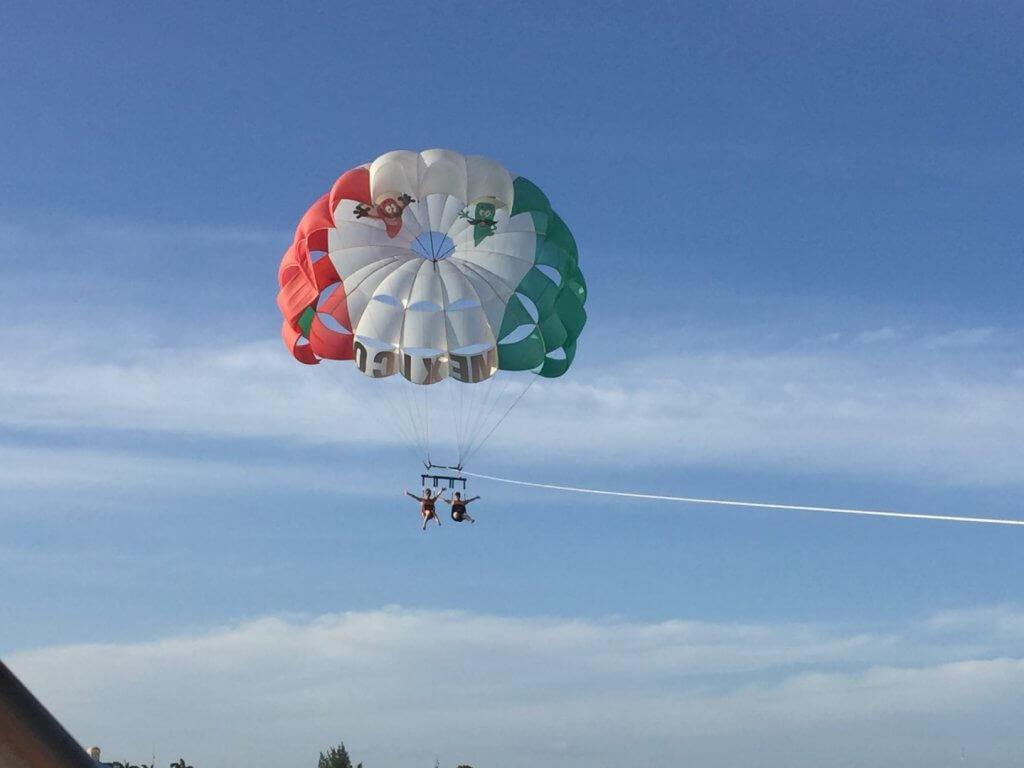 two girls parasailing