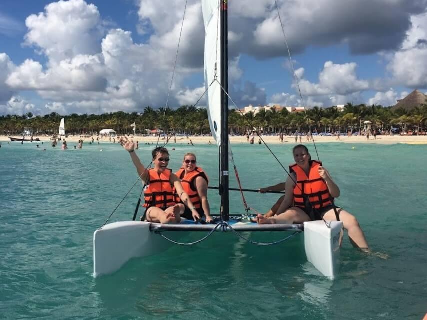 women on a catamaran
