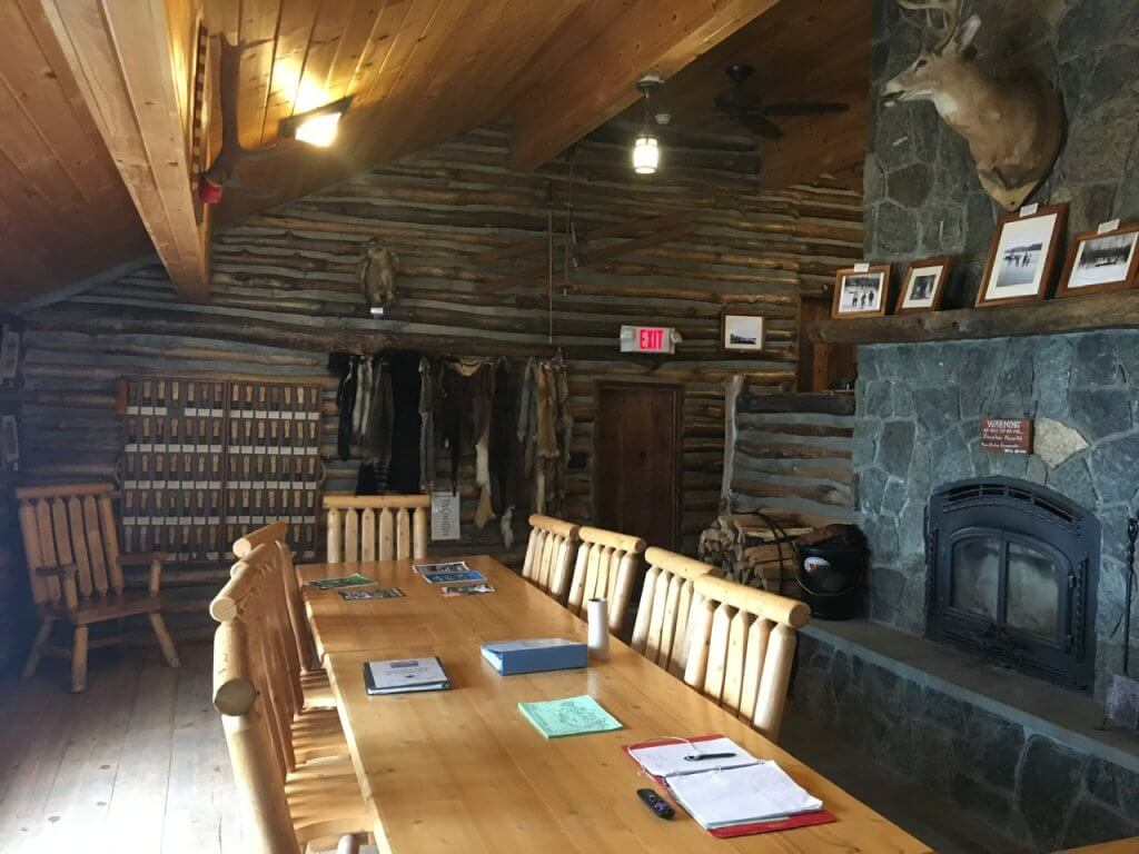 table and fireplace in cabin