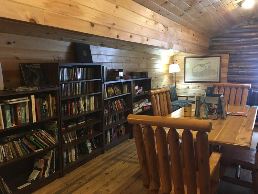 bookshelves with table in cabin
