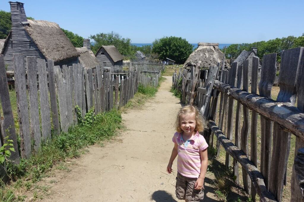 girl on a path with old buildings