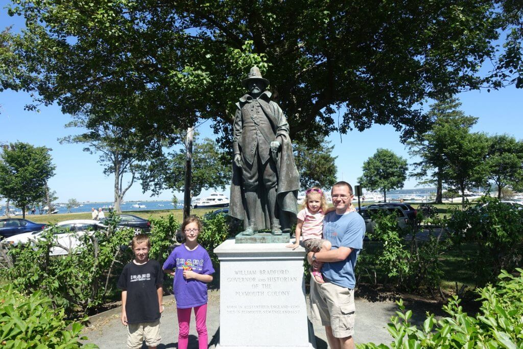 family by a statue