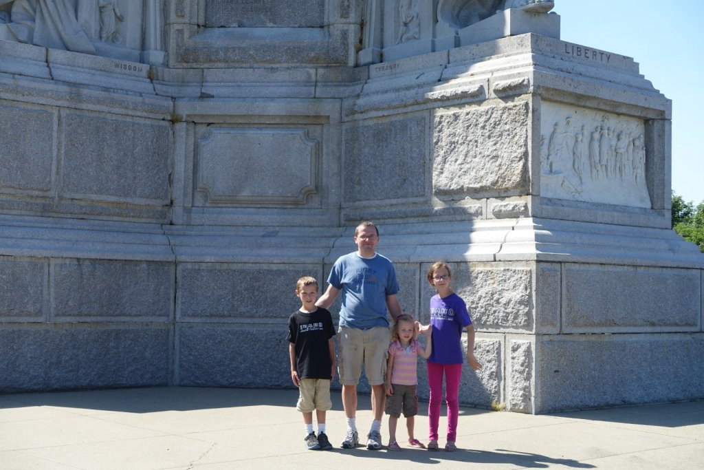 family in front of a monument