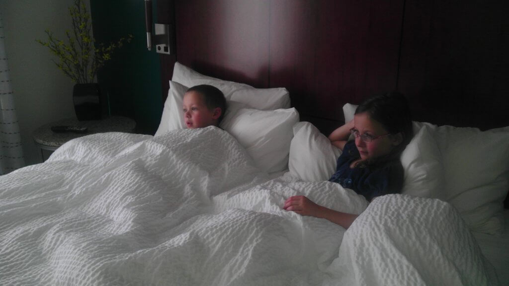 girl and boy in big bed