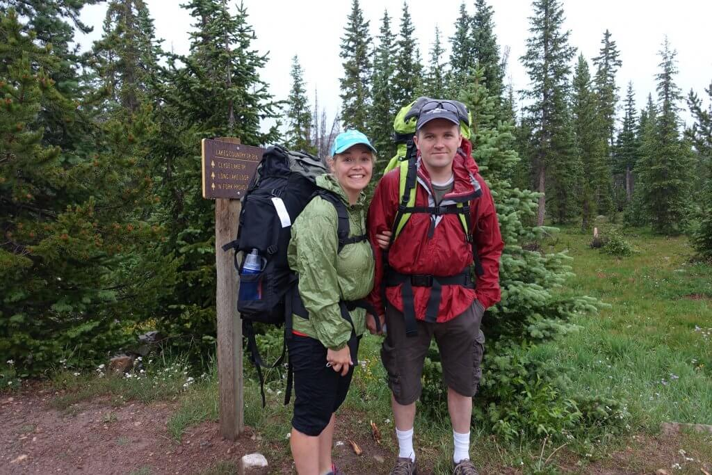 two adults with backpacking gear