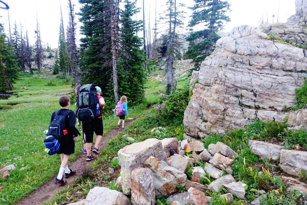 family hiking with backpacks
