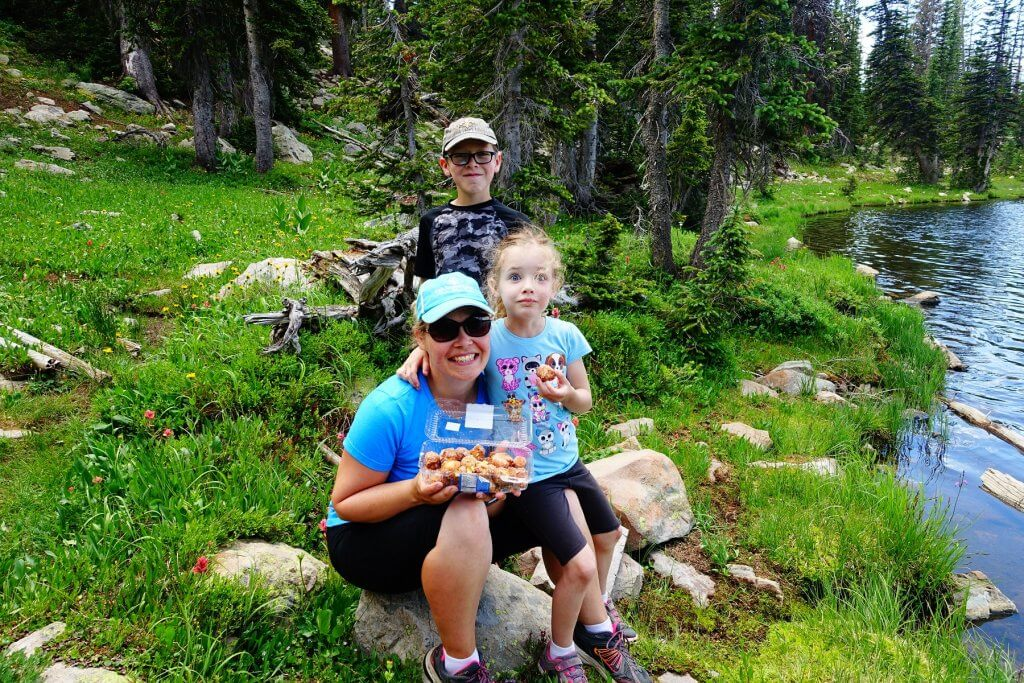 mom and kids with donuts in the mountains