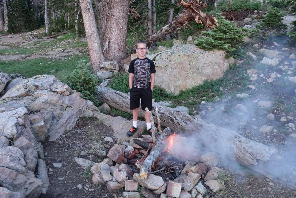 boy with campfire