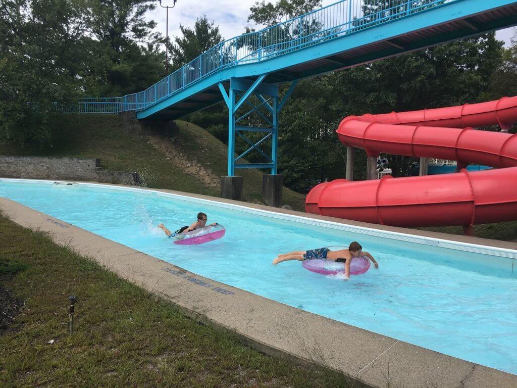 two boys on tubes in lazy river