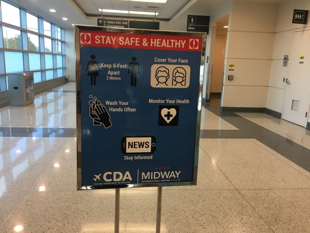 health guidelines sign in airport