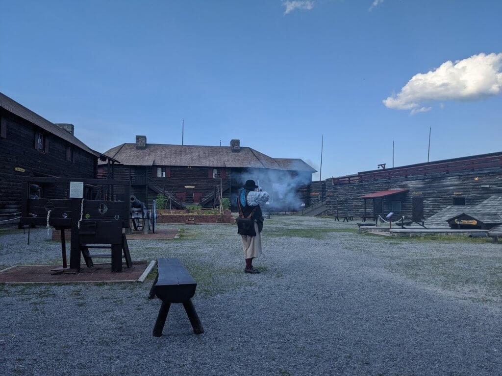 man shooting musket