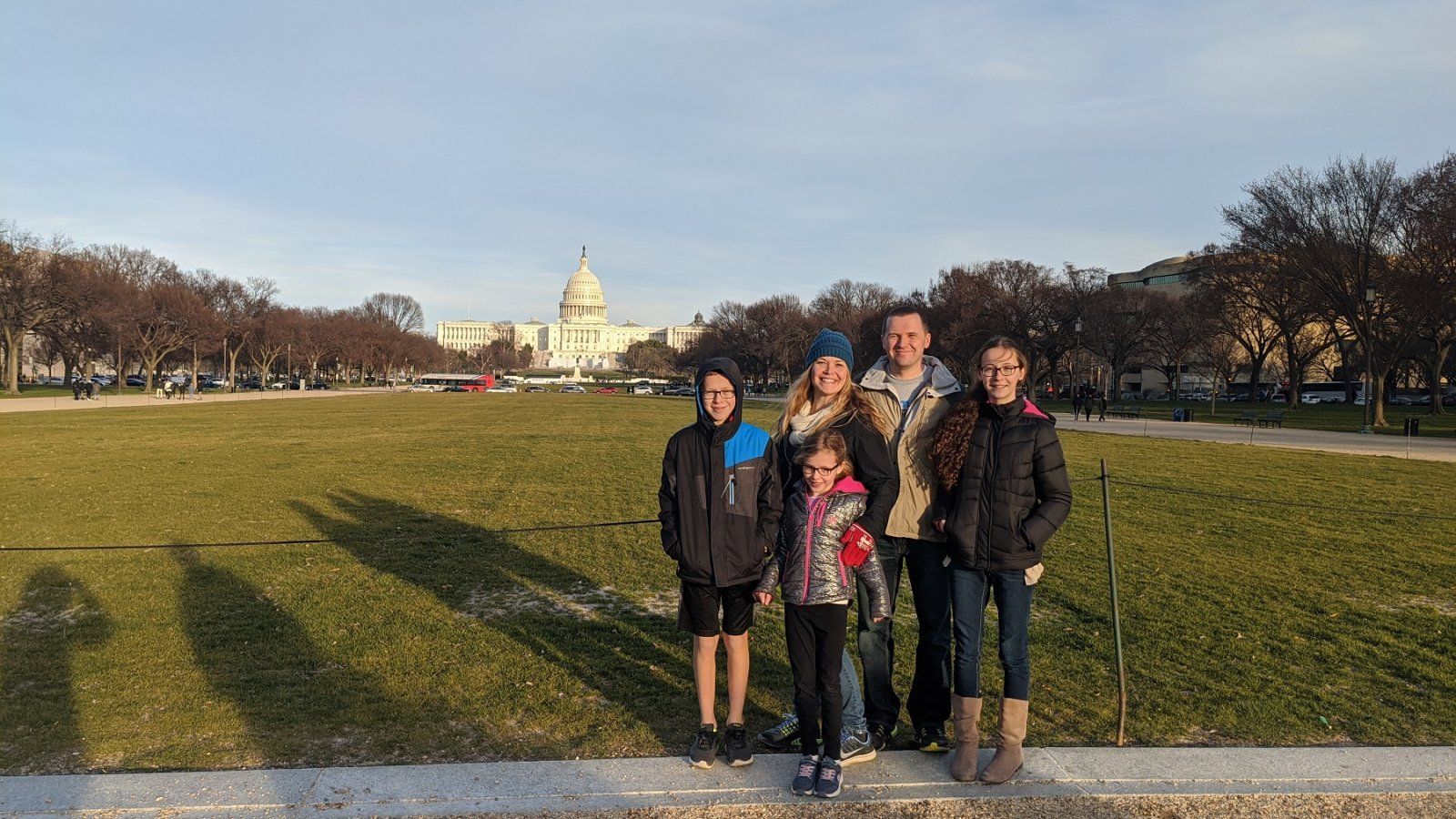 family in front of building