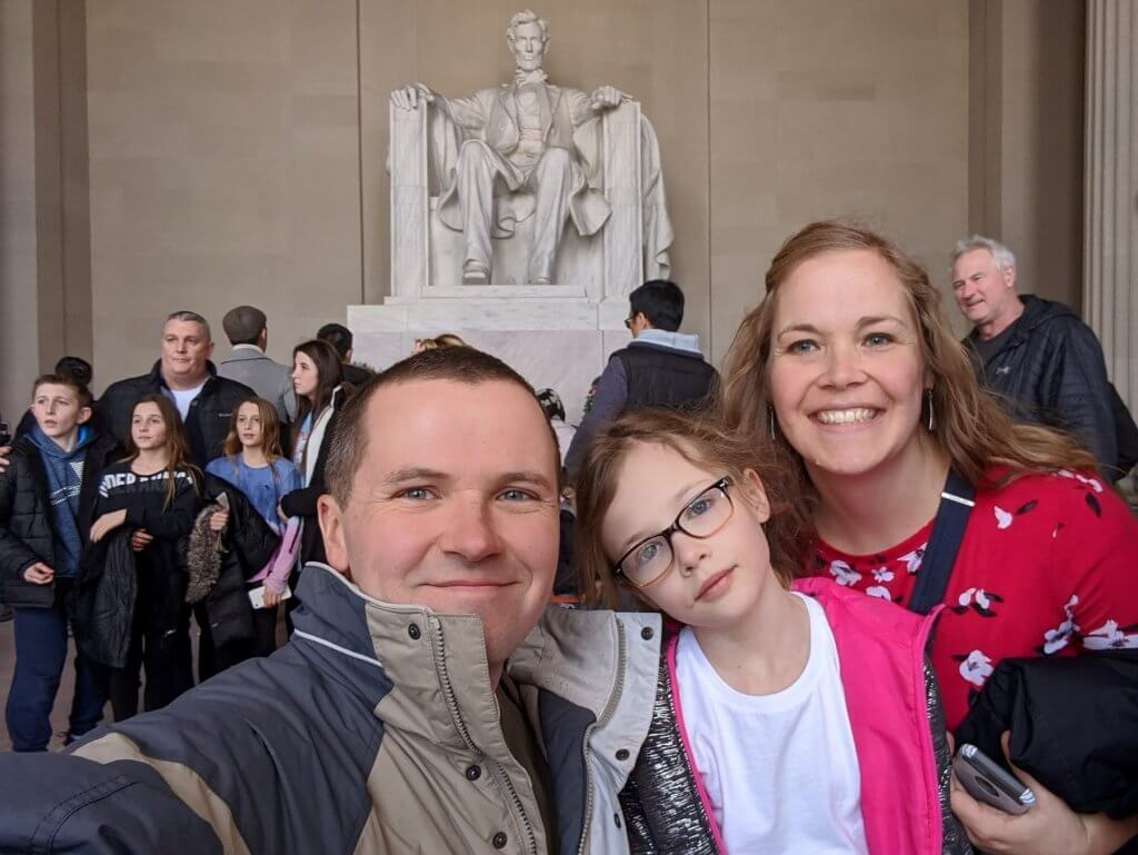 people in front of Abraham Lincoln statue
