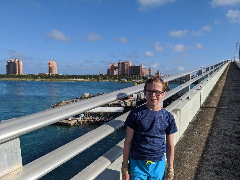 Boy on bridge in front of Atlantis Resort