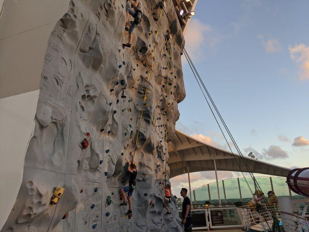 people on rock climbing wall